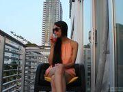 d3l1ghtfulhug - orange dress balcony tease