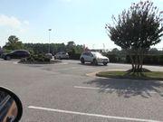 Blowjob in a car parking lot