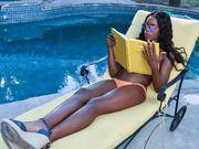 Chocolate bikini chick on pool guys white dick