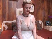 Busty blonde undresses herself and masturbates