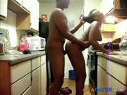 Ebony couple doggy fucking in the kitchen