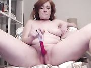 Ginger toys her wet pussy